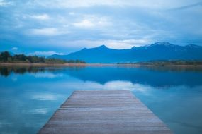 wooden pier on freshwater lake chiemsee