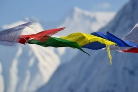 tibetan prayer flags on top of a mountain