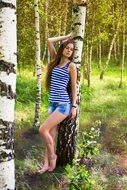 girl at a photo shoot in a birch grove