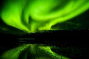 painted green northern lights on a dark background