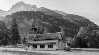 church in mountains in black and white