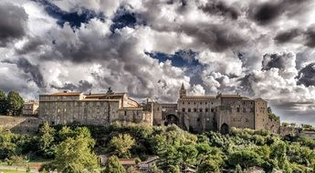 medieval castle under the clouds