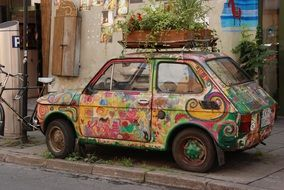 box with flowers on an old multi-colored car