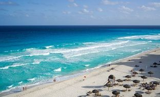 people and parasols on Beach at beautiful sea, Mexico, Cancun