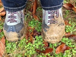 boots in the mud on autumn foliage