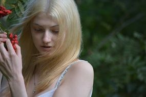 sensual girl with long blonde hair in nature close-up