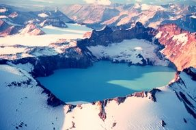 Crater of Dormant Volcano in snowy mountain Landscape, usa, alaska