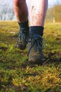 man in walking boots on the grass