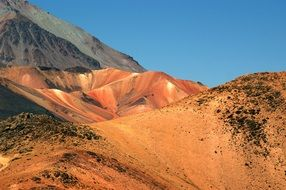 picturesque red and grey Mountains at blue sky, Peru, Andes