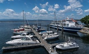 ship at coast, motor and sailing boats at pier on Lake Champlain, usa, Vermont, Burlington