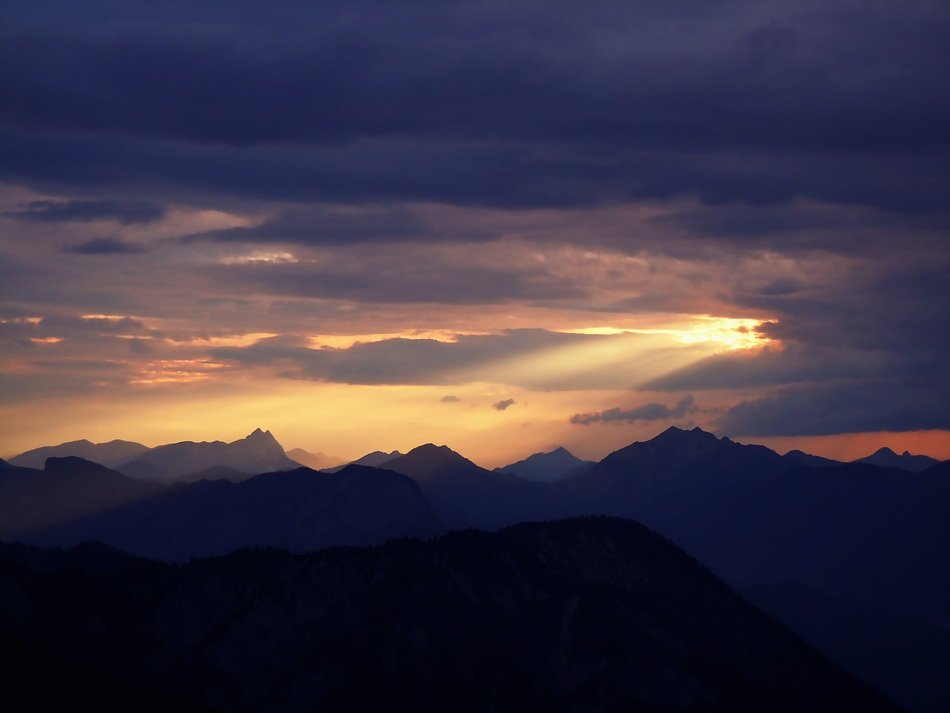 clouds at sunset over high mountains