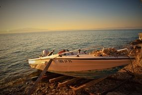 boat in the evening sun on the beach