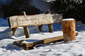 wooden bench in the snow