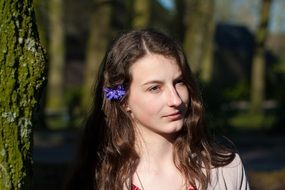 photo of a girl with a cornflower in her hair