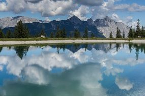picturesque mountains are reflected in the water in Seefeld