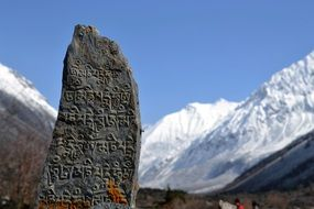 large stone with inscriptions in the Himalayas