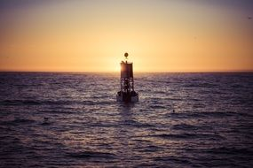 ocean buoy at sunset