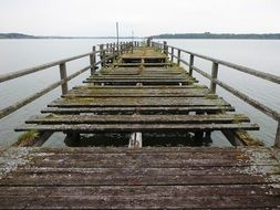 old broken wooden bridge on lake Chiemsee in Germany