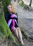 blonde young woman in the forest