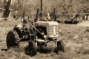 retro photo of a tractor on a farm in New Mexico