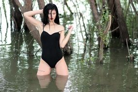 attractive sensual brunette in the black swimsuit