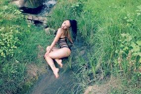 seductive model in swimsuit in the creek