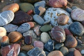 colourful Round Pebbles in the beach closeup