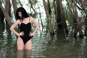 model with black hair in the water