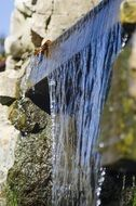 water cascade among stones close up