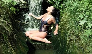 sensual woman in small water cascade