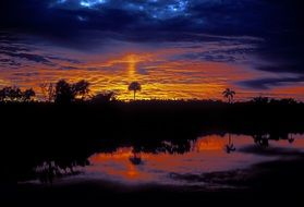 sunrise in the clouds over the everglades national park