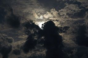 moonlight through the stormy sky