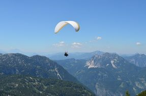 Paraglider in mountains