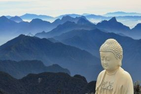 Buddha statue on the background of mountain ranges