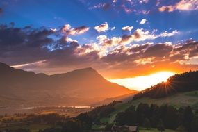 romantic sunset in the mountains of switzerland