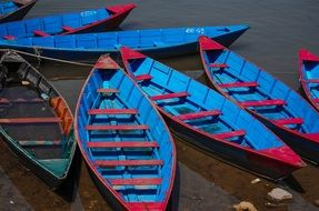 blue boats on a lake in Nepal
