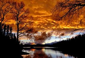 golden clouds over a lake in quebec at sunset