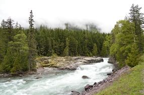 stormy mountain river with a glacier in montana