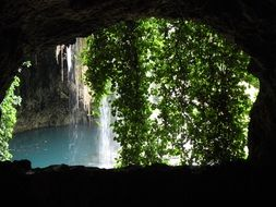 cave behind a waterfall