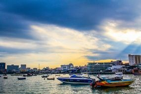 colorful motor boats in bay at sity, thailand