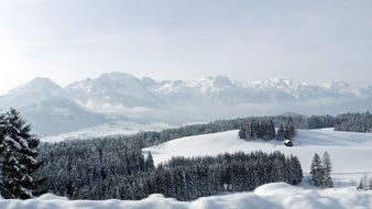 panoramic view of the tennengebirge mountain range in winter