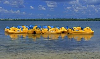 Yellow and blue boats in the water