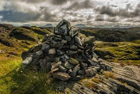 heap of stones Lochinver Coast Scotland Sea