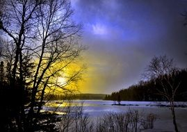 sunset over a lake in quebec in winter