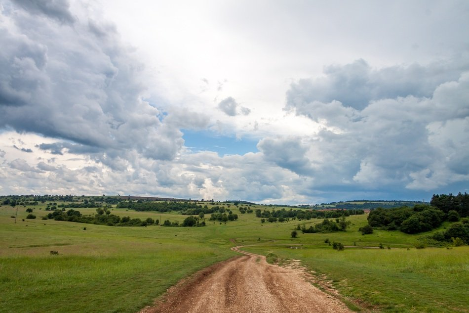 soil Road in summer Landscape under scenic Clouds, bulgaria