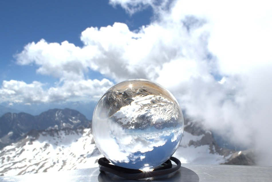 glass ball on top of a glacier