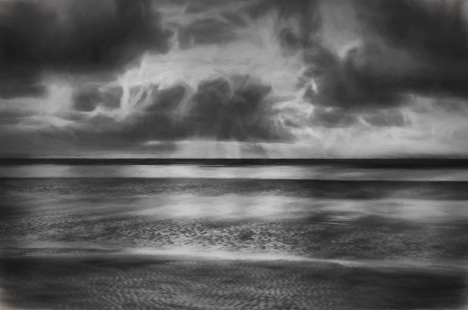 black and white photo of a beach near the north sea