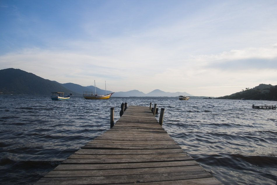 landscape of wooden pier on the ocean in Santa Catarina, Brazil