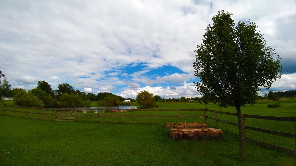 remote view of a pond in a picturesque countryside
