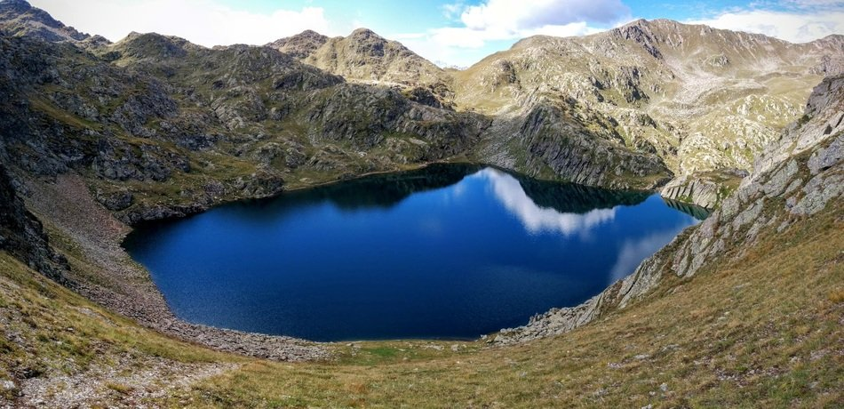 panorama of a mountain lake in south tyrol